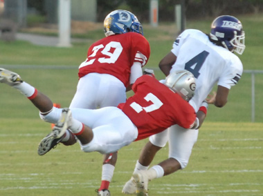 Keith Ray of Vigor tackles Dezman Ivory of Minor in 2009 All-Star Week football game. (KDPSportsPhoto)