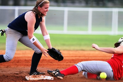 South's Tiffany Schultz of Wetumpka slides safely into second base as Erin Hornsby of Spain Park awaits low throw during softball action. (Photo courtesy creative fx)