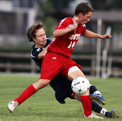 Benson Mulavney of Briarwood Christian and Evan Chavers (14) of Prattville battle in 2011 action. (Creativefx photo)