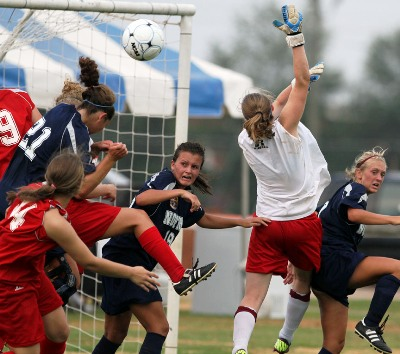 Action aplenty at the goal during the girls soccer match. (Photo courtesy creativefx)